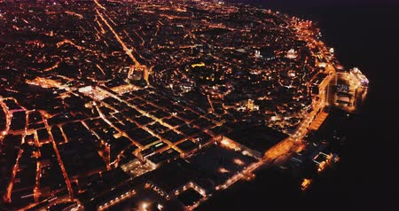impressive skyline : Aerial view of illuminated downtown of Lisbon overlooking Commerce Square with Rua Augusta Arch at night, Portugal
