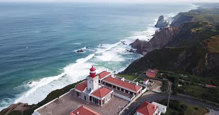 континентальный : View from drone of rocky Atlantic coast of Cabo da Roca with lighthouse in sunny day, Portugal