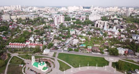 scenes : Aerial view of Admiralty square of Voronezh with Assumption Church and Ship Museum on background with modern cityscape, Russia Stock Footage