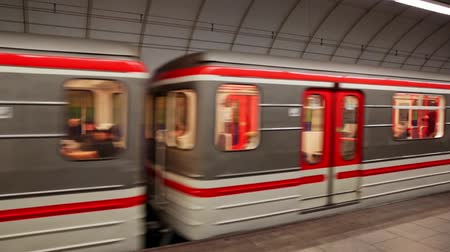 rapid transit : PRAGUE, CZECH REPUBLIC - OCTOBER 13, 2019: View of modern train arriving at Hloubetin station in Prague Metro Stock Footage