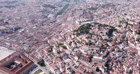 sao : Picturesque aerial view of historical areas of Lisbon on bank of Tagus river overlooking medieval Roman Catholic Cathedral, Portugal