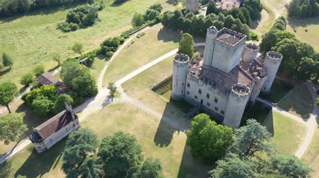 tutmak : Picturesque summer landscape with imposing medieval Roquetaillade Castle in French commune of Mazeres, Gironde