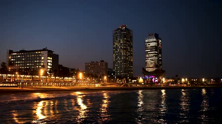 metropolitan area : Evening view of new seaside of Barcelona - center of nightlife. Catalonia, Spain