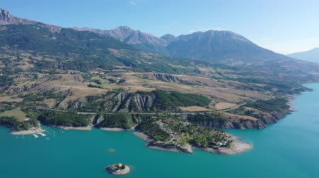 foothills : Picturesque view over artificial lake of Lac de Serre-Poncon in departments of Hautes-Alpes and Alpes-de-Haute-Provence, France