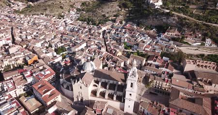 maria : View from drone of Roman Catholic Basilica in Spanish town of Xativa on background of residential areas