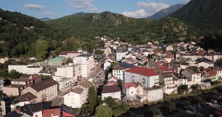 топор : Aerial view of small French town of Ax-les-Thermes on banks of mountain river of Ariege on summer day
