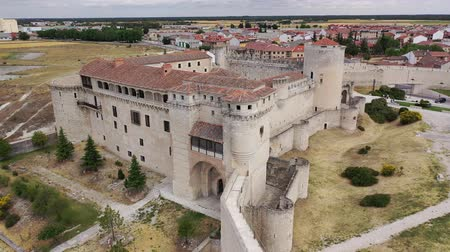 segovia : Scenic view from drone of Cuellar cityscape with medieval Castle of Dukes of Alburquerque, Spain