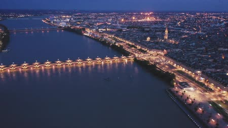 Бордо : Aerial view of Bordeaux cityscape on banks of Garonne river and Pont de pierre at night Стоковые видеозаписи