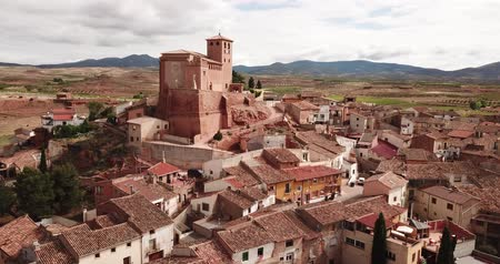 mudejar : View from drone of Cervera de la Canada cityscape overlooking fortified Catholic church of Iglesia de Santa Tecla, Spain