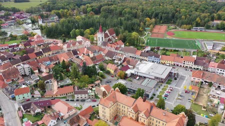 Čechy : Scenic view from drone of ancient Blatna downtown with reddish roofs of houses, gothic Bell Tower and Water castle, Strakonice district, Czech Republic