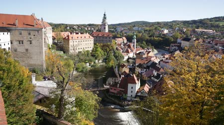 Čechy : Scenic view of historical centre of Czech town of Cesky Krumlov overlooking gothic bell tower of Cathedral of Saint Vitus on sunny autumn day