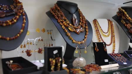 showcase : Close up of natural amber jewelry in jewelry shop