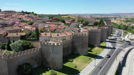 fortificado : Aerial view of imposing stone defensive walls around historic Spanish city of Avila