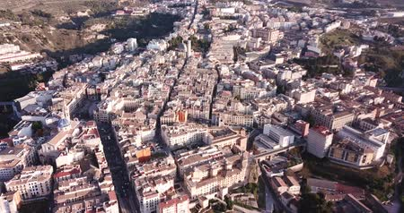 View from drone of residential areas of Spanish town of Alcoy with Iglesia arciprestal de Santa Maria