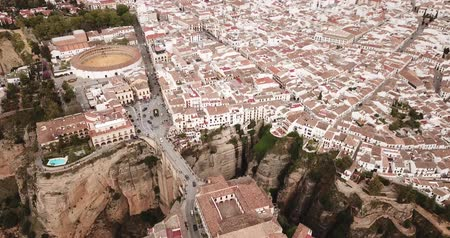 Aerial view of rocky landscape of Ronda with buildings and Bridge, Andalusia, Spain Stock mozgókép