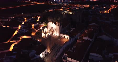 Night aerial view of Portuguese city of Sepra with illuminated clock tower