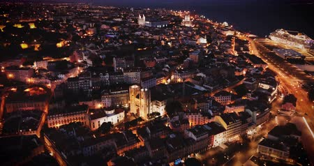 Night aerial view of downtown of Lisbon overlooking medieval Cathedral and Castle of Sao Jorge, Portugal Stok Video