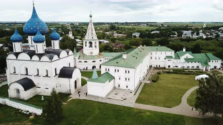 Aerial panoramic view of Cathedral of Nativity of Virgin in Suzdal Kremlin on cloudy summer day, Russia