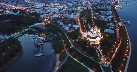 Scenic view from drone of medieval Yaroslavl Orthodox Assumption cathedral on background with Volga River and cityscape at night, Russia
