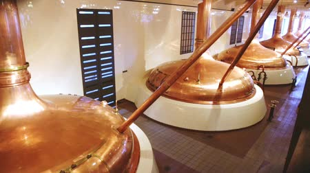 pivovar : Vintage copper brewing kettles in modern brewery. Equipment for production of craft beer
