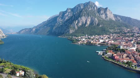 Spectacular view of Italian city of Lecco at foot of San Martino mountain on shore of Lake Como overlooking gothic bell-tower of Minor Basilica of San Nicolo, Lombardy Stok Video