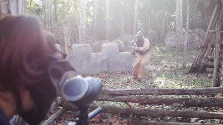 point of interest : Teams of friends facing on battlefield in outdoor paintball arena