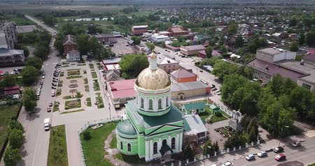 templomtorony : View from drone of Ozyory cityscape with golden dome of Holy Trinity Church on spring day, Russia Stock mozgókép