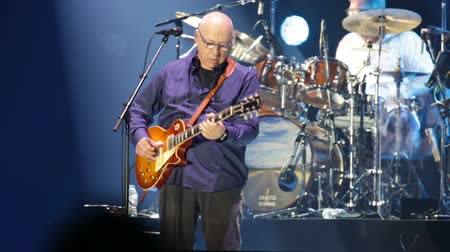 vokální : BARCELONA, SPAIN - APRIL 26, 2019: Mark Knopfler performing live on stage of famous Palau Sant Jordi