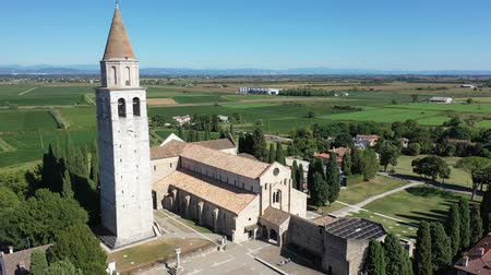 maria : Aerial view of summer landscape of Aquileia township overlooking Basilica di Santa Maria Assunta with Gothic bell tower, Italy