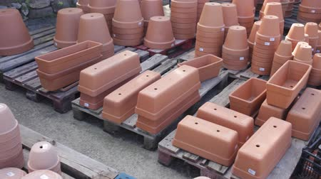 kamenina : Clay pots of various shapes and sizes for flowers and garden plants for sale on open market