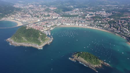 mooring : Scenic view from drone of Spanish town of San Sebastian (Donostia) on southern coast of Bay of Biscay on sunny summer day, Basque Country