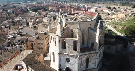 templomtorony : View from drone of town of Montblanc and Santa Maria cathedral, Catalonia Stock mozgókép