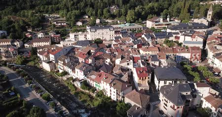 топор : Aerial view of Ax-les-Thermes with buildings and The Lauze river in  France, Midi-Pyrenees