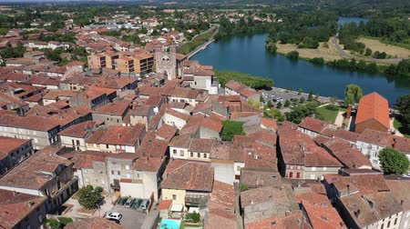 suyolu : Picturesque aerial view of Cazeres cityscape on bank of Garonne river on sunny summer day, France