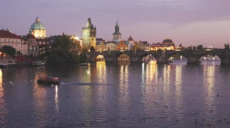čeština : Picturesque view of city of Prague and Charles Bridge at night, Czech Republic