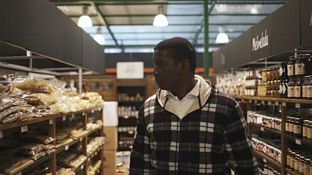 grocery store : African American man buying natural organic groats in supermarket