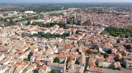 reddish : Picturesque aerial view of Narbonne cityscape overlooking ancient Gothic building of Cathedral of Saints Justus and Pastor, France Stock Footage
