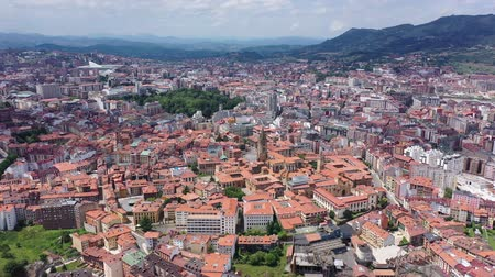 forestal : Panoramic aerial view of Oviedo city surrounded by mountain ranges on sunny summer day, Asturias, Spain Stock Footage