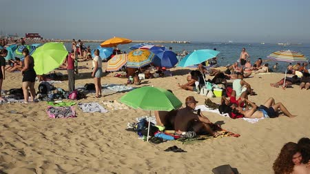 iberian : BARCELONA, SPAIN - JUNE 29, 2019: Crowded beach in Barcelona seaside, Spain