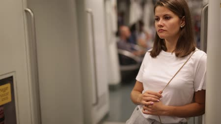 rapid transit : Portrait of positive girl standing in underground coach