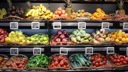 объем : View of showcase with fresh ripe fruits and vegetables in greengrocery
