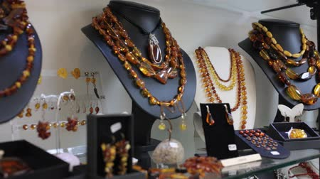 кулон : Close up of natural amber jewelry in jewelry shop