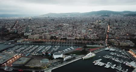 estacionado : Night aerial  view from drones of old port in Barcelona with of sailboats and yachts and gothic quarter,  historical part of the city