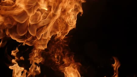 tutku : Slow motion of fire blasts isolated on black background. Filmed on high speed camera, 1000 fps