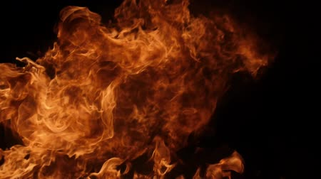 пламя : Slow motion of fire blasts isolated on black background. Filmed on high speed camera, 1000 fps