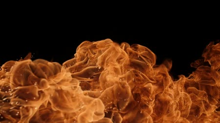 fireball : Slow motion of fire blasts isolated on black background. Filmed on high speed camera, 1000 fps