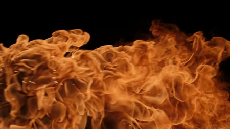 ohnivý : Slow motion of fire blasts isolated on black background. Filmed on high speed camera, 1000 fps