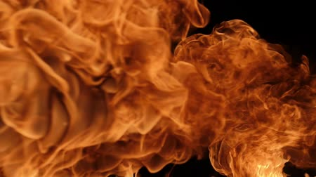 kitörés : Slow motion of fire blasts isolated on black background. Filmed on high speed camera, 1000 fps