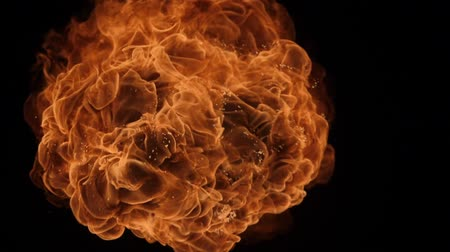ohnivý : Slow motion of fire blasts isolated on black background.