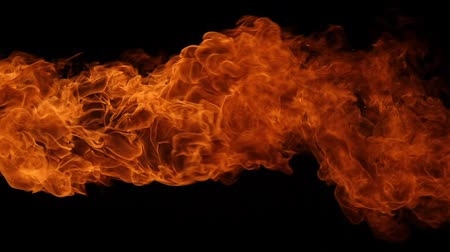 kitörés : Slow motion of fire blasts isolated on black background.